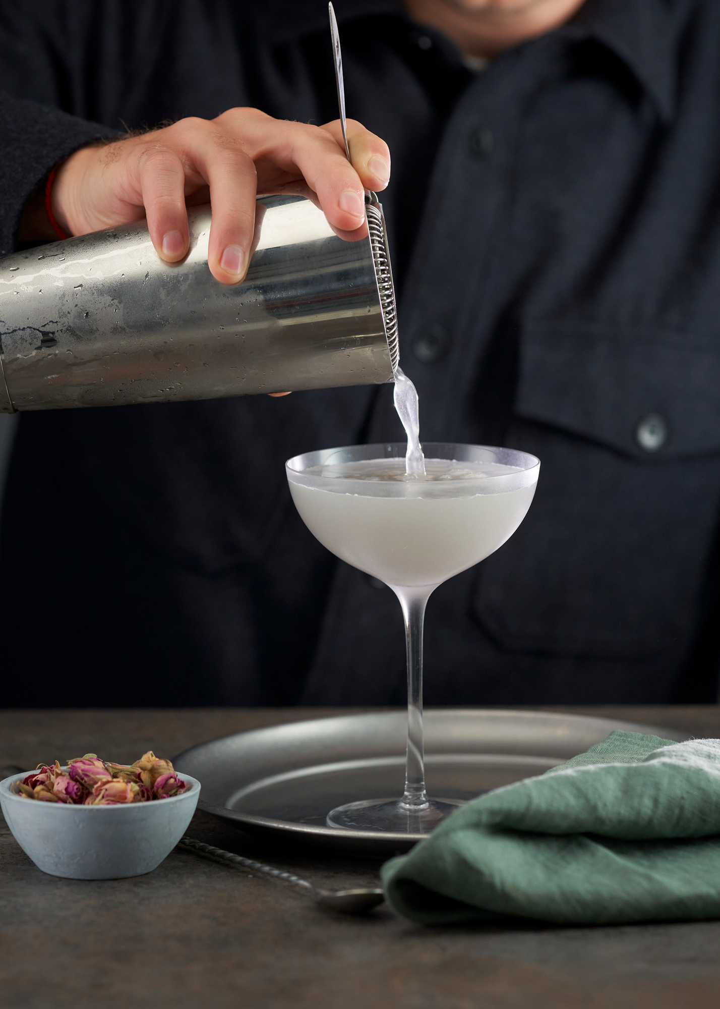 Aviation cocktail being poured