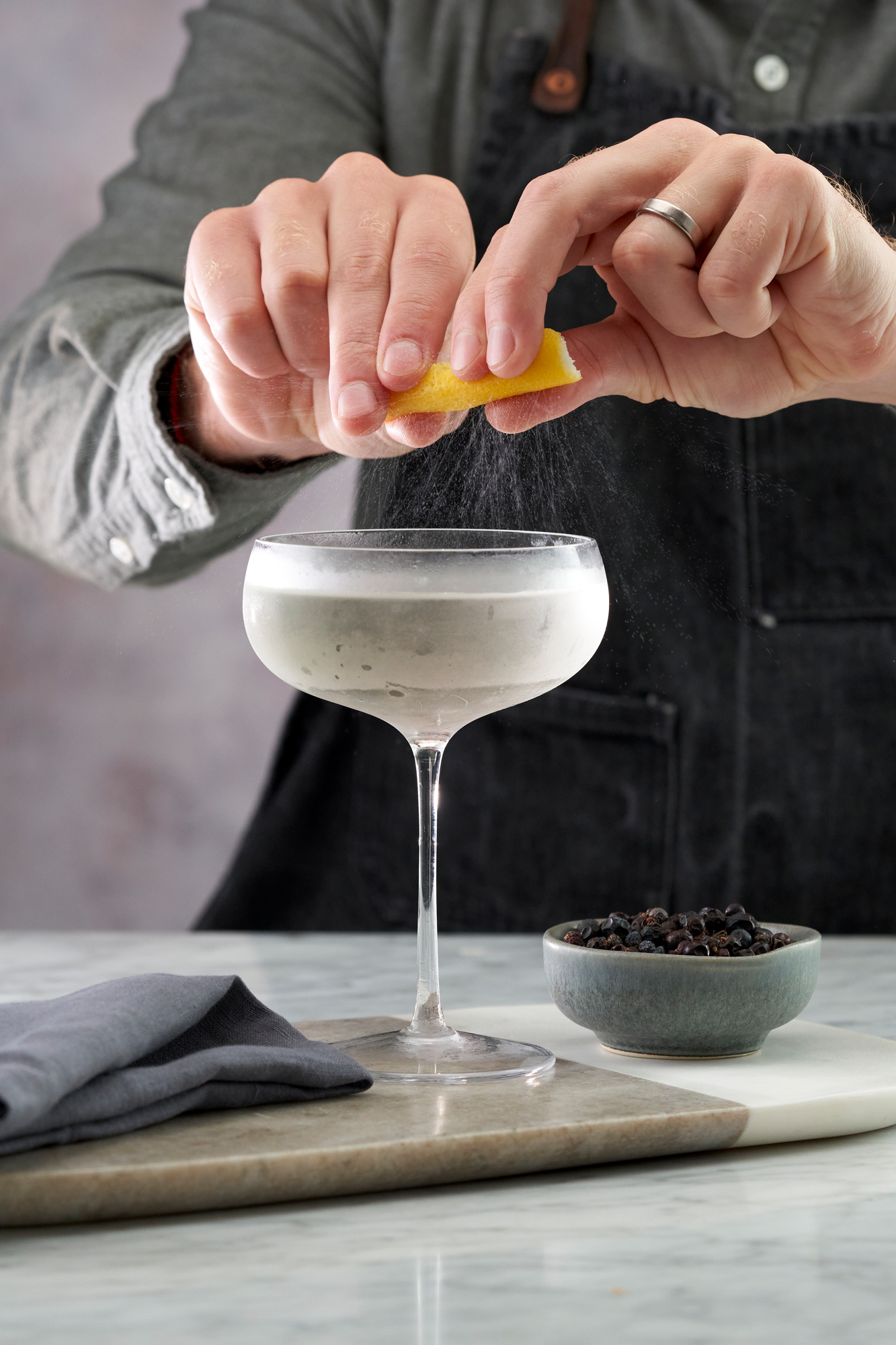 Martini garnished with a zest of citrus